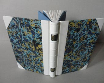 white half leather binding with marble paper