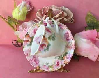 Pretty Victorian Porcelain Demitasse Cup and Saucer with Pink and Peach Roses