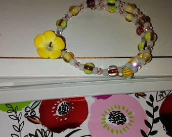 small light yellow/multi-color memory wire bracelet