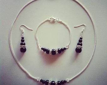 Silver set black beads and rhinestones