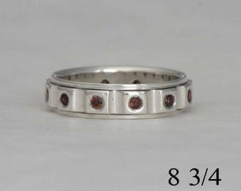 Garnet band, size 8 3/4 ring with twelve 2 mm garnets, #143.