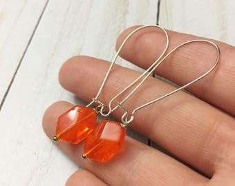 Orange Czech pressed glass and silver tone french ear wire earrings by Jules Jewelry Box
