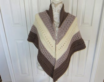 Woman's hand knit soft brown, tan, and cream shawl
