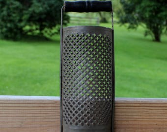 vintage primitive tin grater with black painted wood handle 8 1/2 inch x 3 1/2 inch 1940's kitchen supply excellent condition