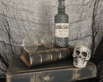 spooky creepy Halloween display decor apothecary Haunted house prop, specimin skull display, human skull, bones, spell books, shelf decor
