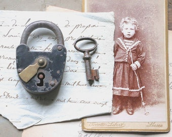 Cute old little padlock with its  little key
