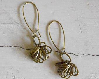 Long earrings made of many rings bronze