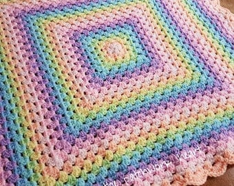 Hand made crochet baby blanket in rainbow shades approximately 58cm square