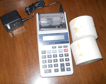 vintage calculator with charger