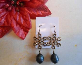Teal pearl snowflake earrings:  Vintaj look antique brass teal snowflake earrings with Vintaj brand earring hooks and pins!