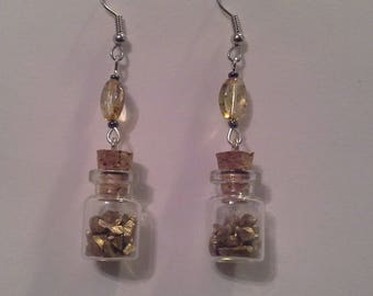 glass vial filled with gold nuggets and Pearl Earrings