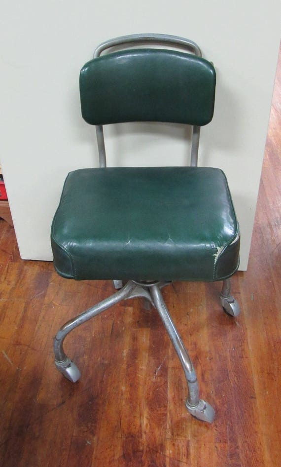 Steelcase swivel chair with green cushions