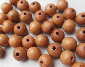 set of 8 round natural wooden beads