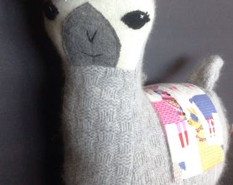 Lulu llama pillow toy in gray basket weave