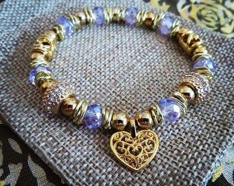 Stainless steel, 14k gold plated spacers and heart. Lavender glass beads.