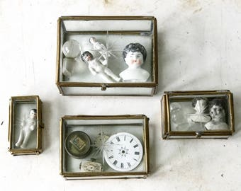 A set of four graduating brass vitrine specimen boxes