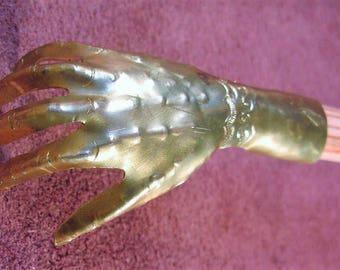 Scratched back Ogovenezia hand Brass