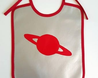 bib bronze with red planet in oilcloth