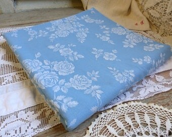 One piece of vintage french blue mattress ticking with white roses. French blue mattress ticking fabric for craft projects. Pillows. Runners