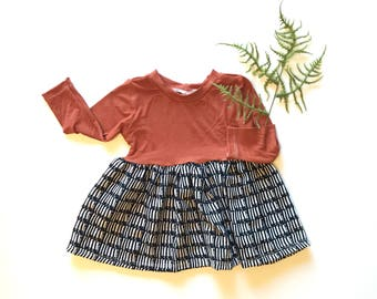 Modern girls dress rust colored.