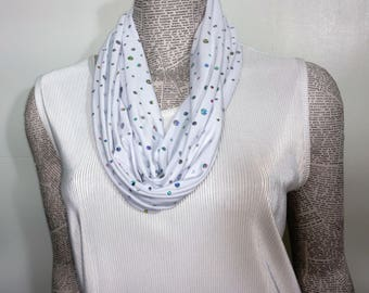 Light weight soft slinky polyester infinity scarf with holographic dots. Drapes beautifully.  Machine surged for durability and is washable