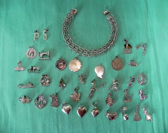 used sterling silver charm bracelet, 35 sterling silver charms