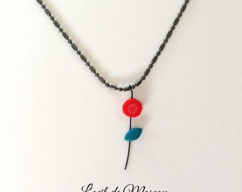 chain and pendant, red flower