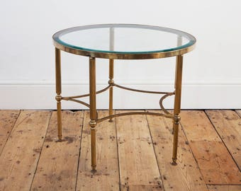 Mid-century brass side table with bevelled glass top.
