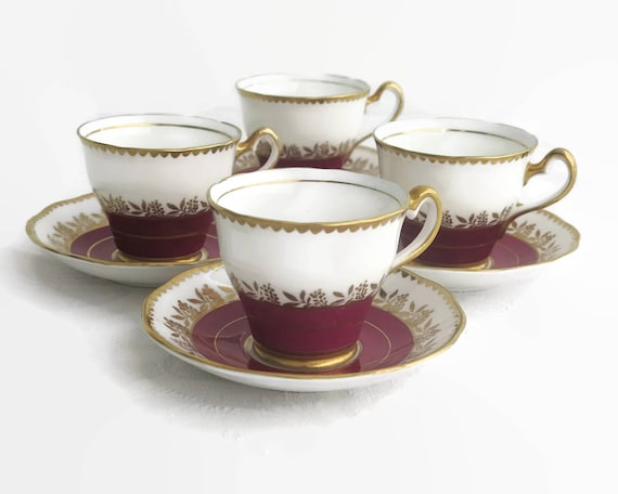Vintage Salisbury cup and saucer, bone china, white background with burgundy bands, gilt trim, gilt leaves and berries, England, 1940s