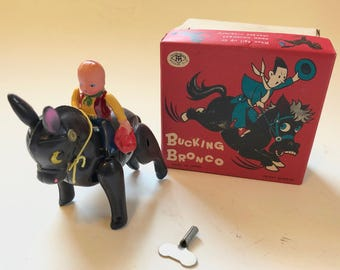 Vintage Japanese Celluloid Wind Up Bucking Bronco