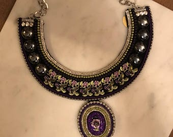 Beautiful purple colored bib necklace