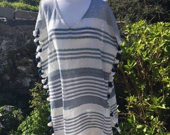 Striped blue and white cotton beach cover-up with pom pom trimming