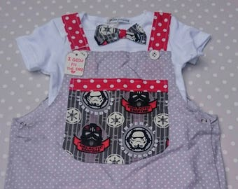 Glow in the dark Star Wars storm trooper dungarees suit with bow tie vest detail. 12 to 18 months