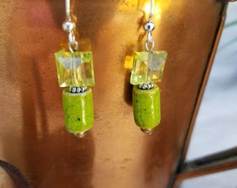 Beautiful green dangle earrings. Using new and recycled beads