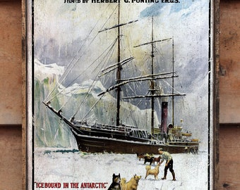 Vintage wooden sign ' Icebound in the Antarctic ' reproduction concept.