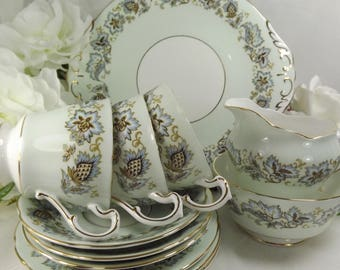 Paragon 3 Teacups, 3 Saucers, 3 Plates PLUS Cakeplate PLUS  Sugar and Creamer excellent Unused