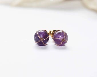 Gold plated stud earrings with amethyst stones