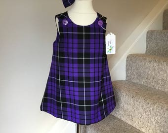 Girls tartan pinafore *Purple tartan*,  *made in Scotland*, *marching hair bow*. Age 2 and 3 years