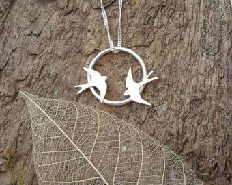 Sterling silver swallows in flight pendant