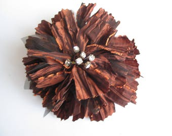 Brown ruffled shiny fabric with Center rhinestone flower brooch