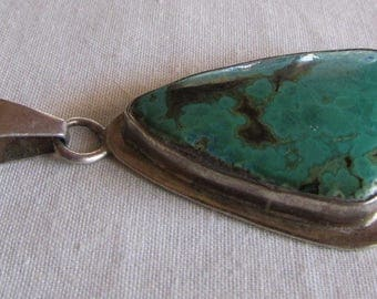 Sterling Silver and Greenish Blue Stone Pendant