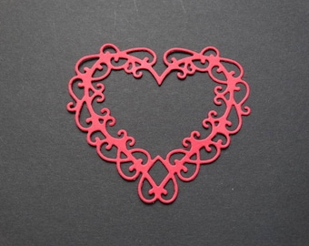 small striped heart with tiny red heart
