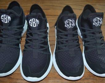 Solid black monogram tennis shoes
