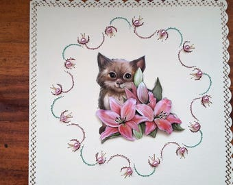Brown kitten and pink flowers