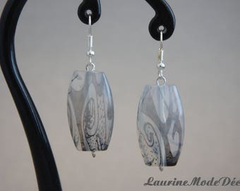 Boucles d'oreille transparente et noire, structure argentée