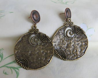 EARRINGS in bronze, worked and beautifully cut.
