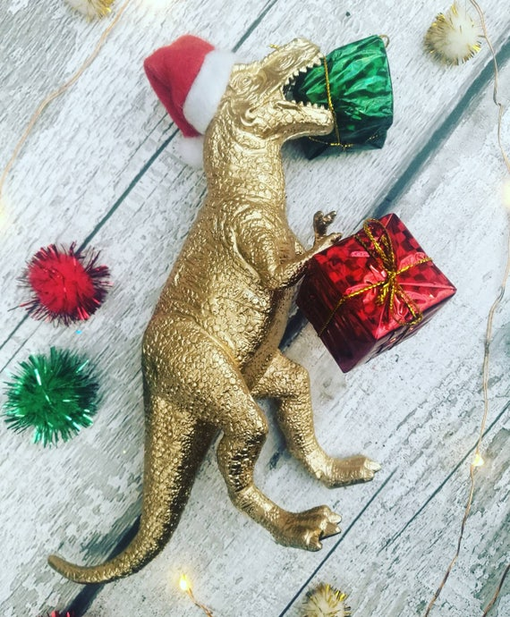 https://www.etsy.com/uk/listing/569736243/gift-eatting-t-rex-dinosaur-christmas?ga_order=most_relevant&ga_search_type=all&ga_view_type=gallery&ga_search_query=christmas&ref=sr_gallery_22