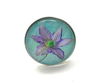 Silver ring, purple flower on turquoise background