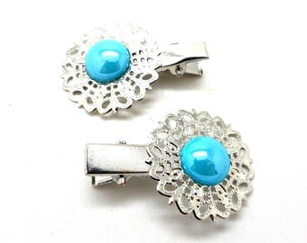 2 hair clips has silvery hair iridescent turquoise cabochon