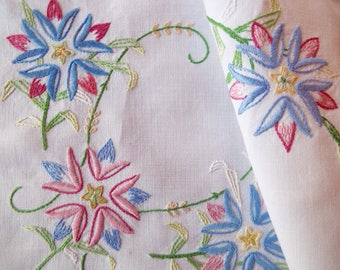 Vintage linen tea tray cloth. A beautiful English white linen tray cloth with hand embroidered pink and blue flowers. Ideal for tea for two